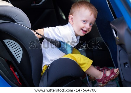 Child sitting in the car baby seat