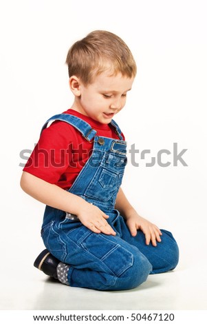Child sitting on the floor - stock photo
