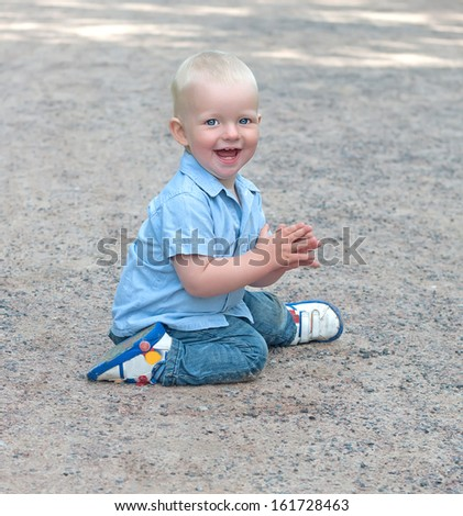 child sitting on the track in the park