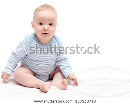 Child sitting on white bed