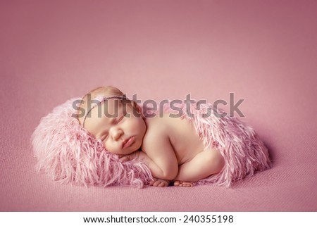 Child sleeping on a blanket