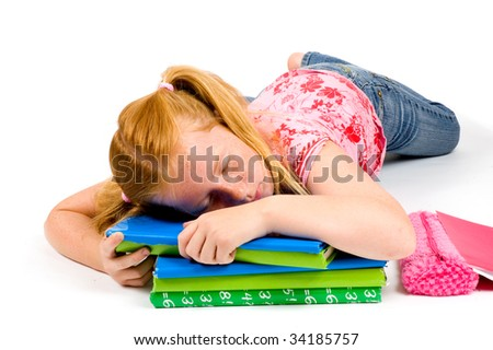 Child sleeping while working on homework on white background - stock photo