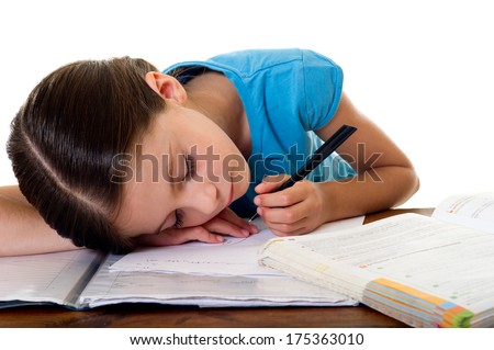 child sleeps while she studies - stock photo