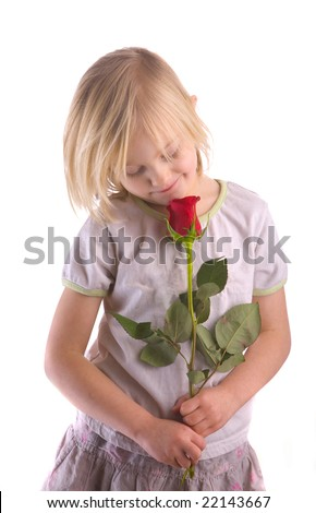 Child smelling red rose against a white background - stock photo