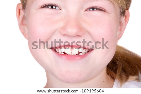 Child smiling close up of mouth, isolated on white