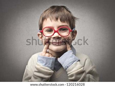 Child smiling forcibly - stock photo