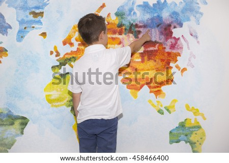 Child, student, boy on the background of the world map