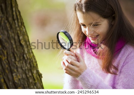 Child studing biology in nature - stock photo