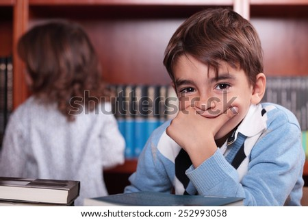 Child studying in the library - stock photo