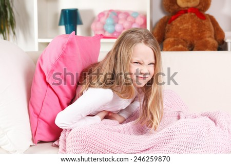 Child suffering from stomach ache - stock photo