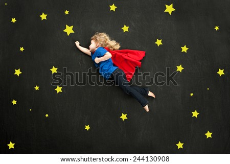 Child super hero concept with stars