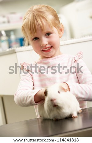 Child Taking Guinea Pig To Veterinary Surgery For Examination - stock photo