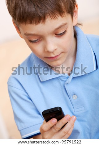 Child, talking on the mobile phone