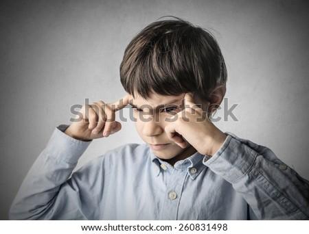 Child thinking of something  - stock photo