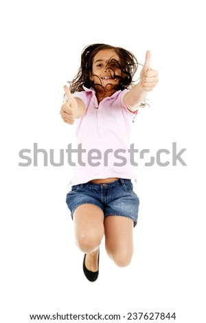 Child thumbs up and jumping . - stock photo
