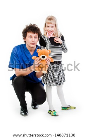 child to the doctor in blue robe - stock photo