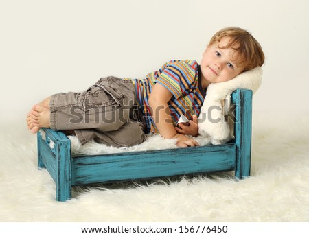 Child toddler on bed, awake, sleeping concept