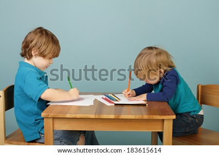 Child, toddler playing with toy trains on tracks, playtime, games