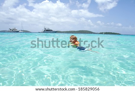 Child, toddler, swimming in a tropical Caribbean ocean, summer vacation