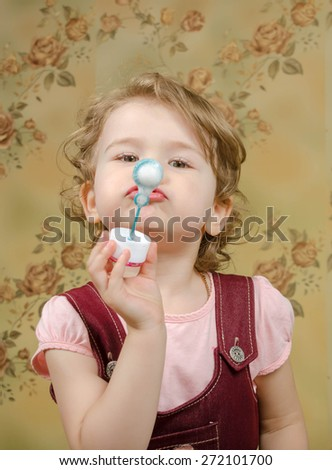 Child trying to catch soap bubble. bubble. bubble. bubble.  bubble.  bubble.  bubble.  bubble. - stock photo