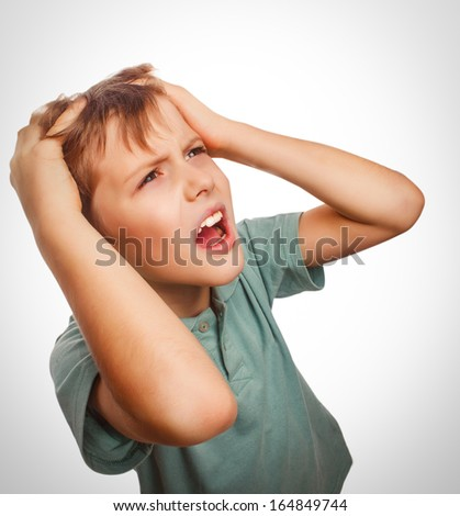 child upset boy angry shout produces evil face portrait isolated emotion - stock photo