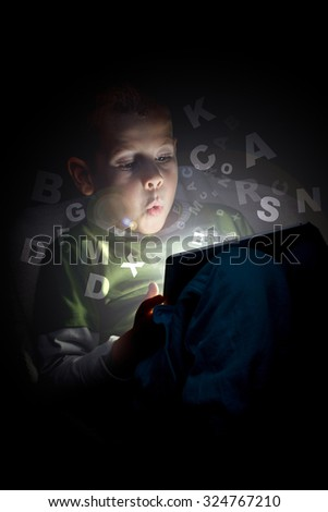 Child using a tablet PC - stock photo