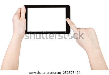 child using tablet pc with cut out screen isolated on white background - stock photo