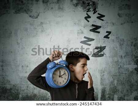 child waking up with alarm clock - stock photo