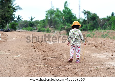 Child walk alone on the road , Child walk