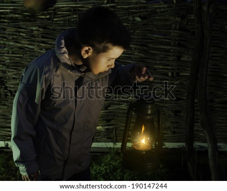 Child walk in the darkness with gas lantern