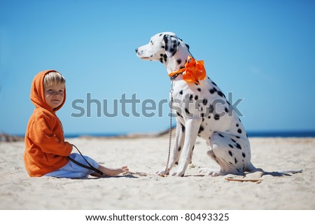 Child walking alone with her lovely dog at beach