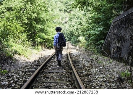 Child walking on railway