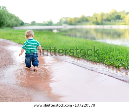 Child Walks On Puddles After Rain Stock Photo 107220398 - Shutterstock