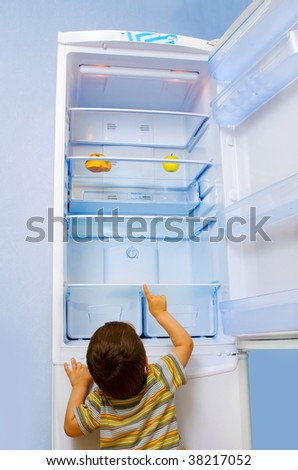 child want to take food from the fridge - stock photo