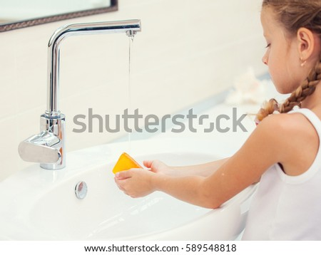 Child washes his hands at bathroom  Girl washing hand with soap. Child Bathtub Girl Washes Bathroom Stock Photo 94971844   Shutterstock