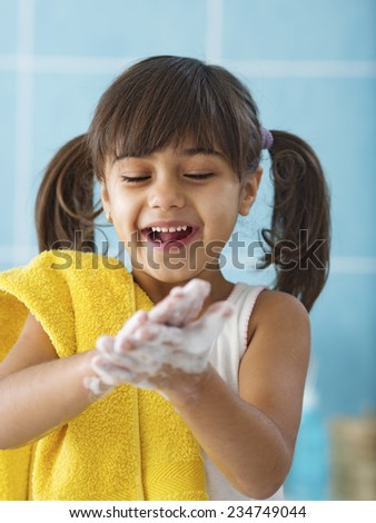 Child washing her hands protecting from germs - stock photo