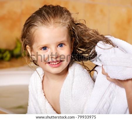 Child washing in bubble bath . - stock photo