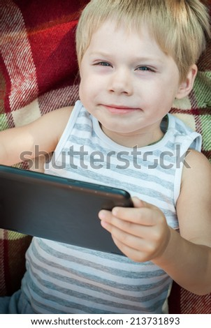 Child Watch a Pad, Laying on Plaid