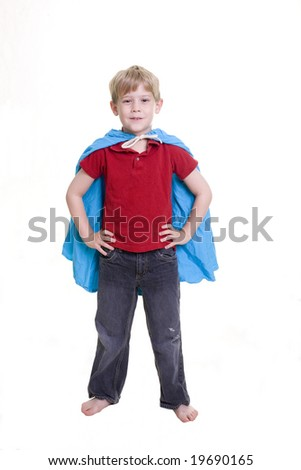 "Child wearing a cape in the ""Superman"" pose"
