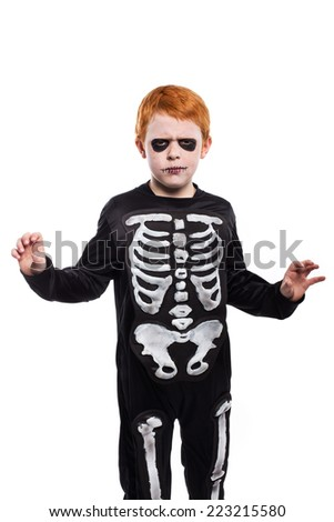 Child wearing halloween costume. Studio portrait isolated over white background - stock photo