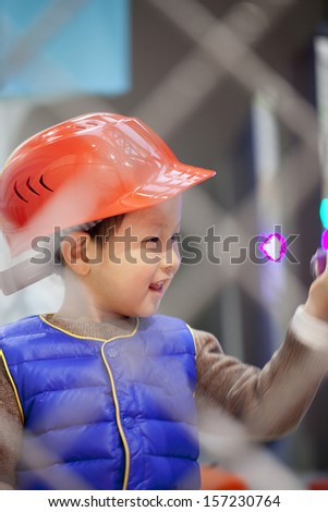 child wearing helmet in a building game