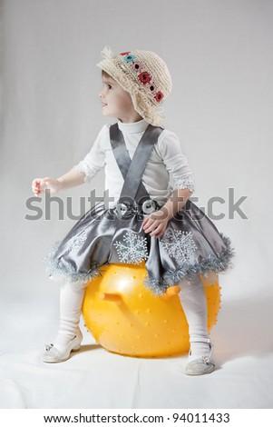 Child white ball on white background. - stock photo