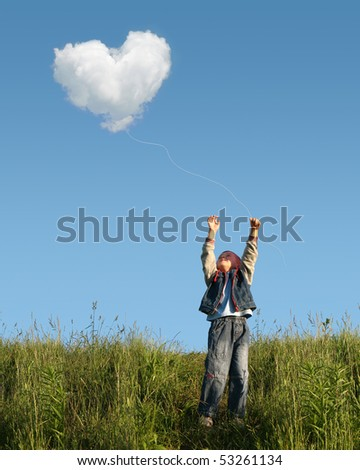child who catches cloud - stock photo