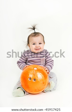 child with a bowling ball - stock photo
