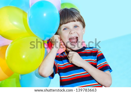 child with a bunch of balloons in their hands