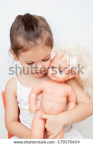 Child with a doll - stock photo