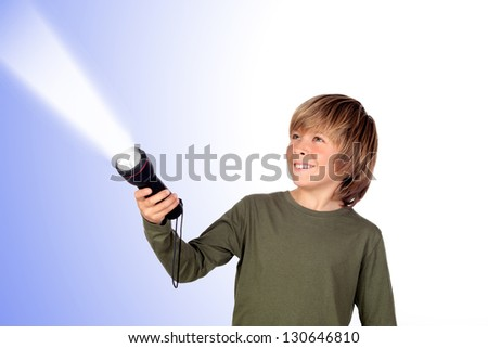 Child with a flashlight looking for something on blue background - stock photo