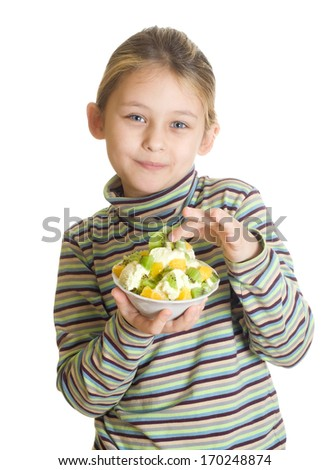child with a fruity dessert isolated on white background