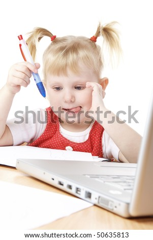 child with a loptop and pen