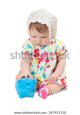 child with a piggy bank on white background - stock photo